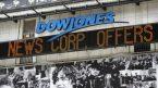 Dow tăng điểm khi tâm lý rủi ro quay trở lại trên thị trường